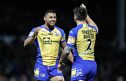 Leeds Rhinos Kallum Watkins celebrates their win against Hull FC with Tom Briscoe, during the Betfred Super League Semi-Final match at the Headingley Carnegie Stadium, Leeds.