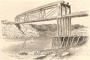 Wrought iron tubular trussed bridge over the river Wye at Chepstow, c1885.  This bridge, constructed 1849-1852, was an innovative design by Sambaed Kingdom Brunel (1806-1859) and the use of wrought iron tubular girders is considered to be a dummy run for his last great masterpiece, the Royal Albert bridge over the Tamar at Saltash.   The Chepstow bridge carried the South Wales Railway over the Wye. Brunel was engineer to the railway.   From 'The Popular Educator'. (London, c1885).