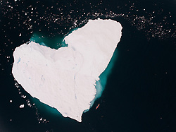 Wednesday 14th December 2016.<br /> Latitude: S64°50.793'<br /> Longitude: W62°31.925'<br /> Bellingshausen Sea,<br /> Antarctica.<br /> <br /> Lewis Pugh Swims Past Heart Shaped Iceberg In Antarctica!<br /> <br /> Lewis Pugh, UN Patron of the Oceans, swims next to a heart-shaped iceberg in the Bellingshausen Sea in Antarctica to launch the #Antarctica2020 campaign. The campaign is to create a series of 6 Marine Protected Areas around Antarctica by 2020.<br /> <br /> Photo By: Kelvin Trautman.   <br /> <br /> For more information please contact Lewis Pugh at:<br /> UK: +44 796 763 4578<br /> RSA: +27 848 428 699<br /> www.lewispugh.com<br /> twitter: LewisPugh<br /> LinkedIn: Lewis Pugh<br /> <br /> Picture supplied to RealTime Images by courtesy of Lewis Pugh and Kelvin Trautman.