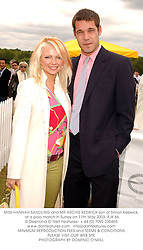 MISS HANNAH SANDLING and MR ARCHIE KESWICK son of Simon Keswick, at a polo match in Surrey on 11th May 2003.PJK 66
