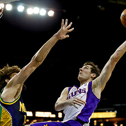Feb 6, 2013; New Orleans, LA, USA; Phoenix Suns point guard Goran Dragic (1) shoots over New Orleans Hornets center Robin Lopez (15) during the second half of a game at the New Orleans Arena. The Hornets defeated the Suns 93-84. Mandatory Credit: Derick E. Hingle-USA TODAY Sports
