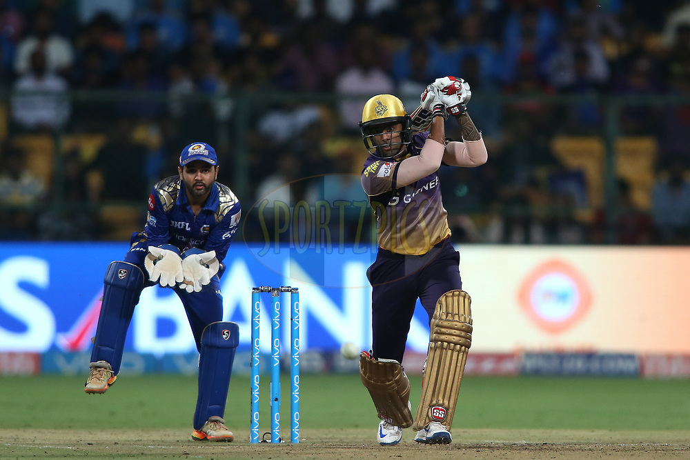Suryakumar Yadav of the Kolkata Knight Riders drives a delivery down the ground during the 2nd qualifier match of the Vivo 2017 Indian Premier League between the Mumbai Indians and the Kolkata Knight Riders held at the M.Chinnaswamy Stadium in Bangalore, India on the 19th May 2017<br /> <br /> Photo by Shaun Roy - Sportzpics - IPL