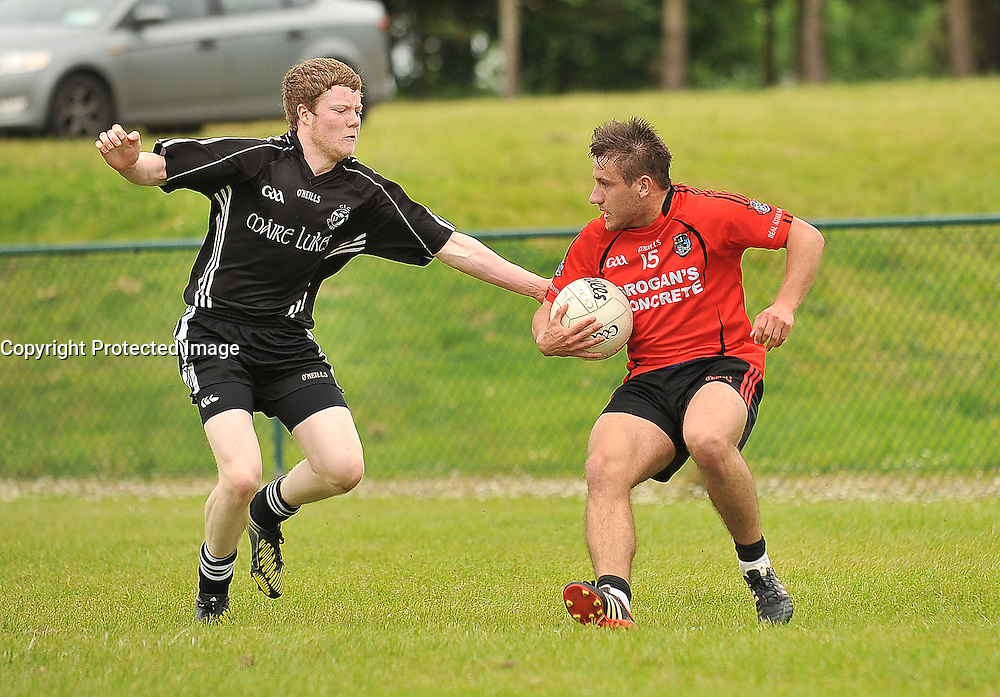Ballyhaunis's Niall Prenty tries to get past Tourmakeady's Donal Breathnach  Mayo intermediate championship match on sunday.<br /> Pic Conor McKeown