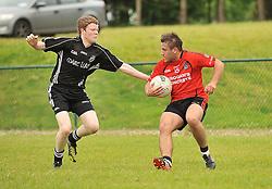 Ballyhaunis's Niall Prenty tries to get past Tourmakeady's Donal Breathnach  Mayo intermediate championship match on sunday.<br /> Pic Conor McKeown