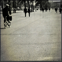 People walking and cycling along a pedestrian area