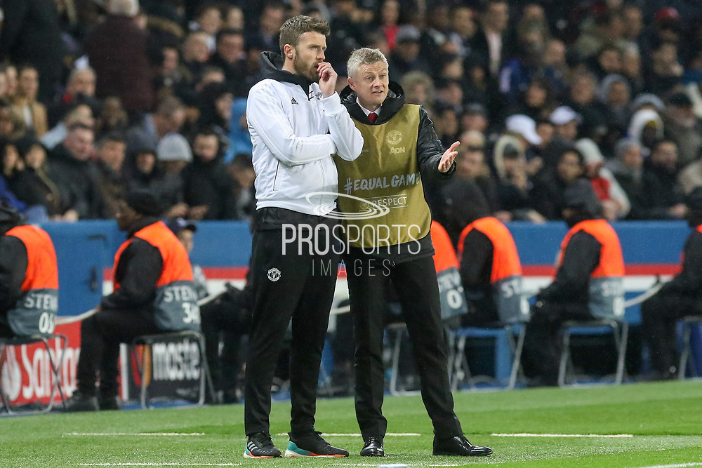 Manchester United interim Manager Ole Gunnar Solskjaer talks to Michael Carrick first team coach of Manchester United during the Champions League Round of 16 2nd leg match between Paris Saint-Germain and Manchester United at Parc des Princes, Paris, France on 6 March 2019.