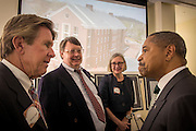 Ohio University President, Roderick McDavis [right], speaks with Michael Doyle, Stephen Sowle, and Leslie Sowle before the Ohio University Residential Housing Phase 1 opening ceremony event began on Saturday, August 29, 2015 at the Living Learning Center on the Ohio University campus in Athens, Ohio. The Sowle family were honored as one of the four new residences halls was bestowed with their family name.