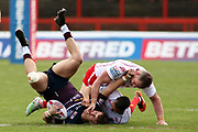 A Leeds Rhinos player is brought down during the Betfred Super League match between Hull Kingston Rovers and Leeds Rhinos at the Lightstream Stadium, Hull, United Kingdom on 29 April 2018. Picture by Mick Atkins.