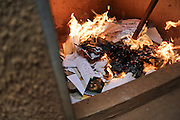 Staffers at LBTI women's rights organization Freedom and Roam Uganda burn informational pamphlets, anti-hate campaign posters, and membership information. Since the Anti-Homosexuality Bill was passed by Parliament in December 2013, they've been working to systematically destroy all physical evidence of their work.
