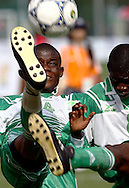 SOCCER PLAYERS FROM NIGERIA (GREEN) DURING FOOTBALL COMPETITION AT THE SPECIAL OLYMPICS WORLD SUMMER GAMES SHANGHAI 2007..SPECIAL OLYMPICS IS AN INTERNATIONAL ORGANIZATION DEDICATED TO EMPOWERING INDIVIDUALS WITH INTELLECTUAL DISABILITIES..SHANGHAI , CHINA , OCTOBER 06, 2007.( PHOTO BY ADAM NURKIEWICZ / MEDIASPORT )..