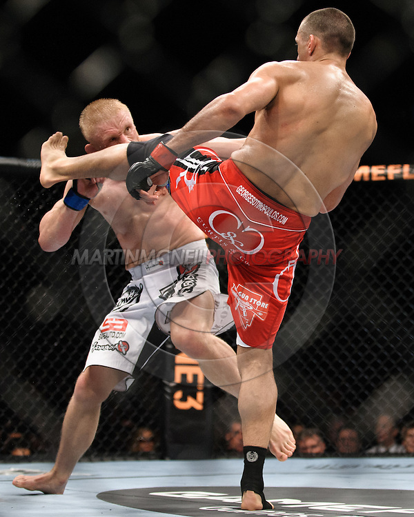 """SYDNEY, AUSTRALIA, FEBRUARY 27, 2011: Dennis Siver (facing) blocks a kick from George Sotiropoulos during """"UFC 127: Penn vs. Fitch"""" inside Acer Arena in Sydney, Australia on February 27, 2011."""