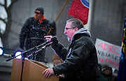 MADISON, WI — FEBRUARY 25: Phil Gruber with the Machinists Union speaks at the podium during a rally in opposition to right-to-work legislation at the Wisconsin State Capitol.