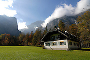 A farmhouse in the background the Watzman, Berchtesgadener land National park, Bavaria, Germany