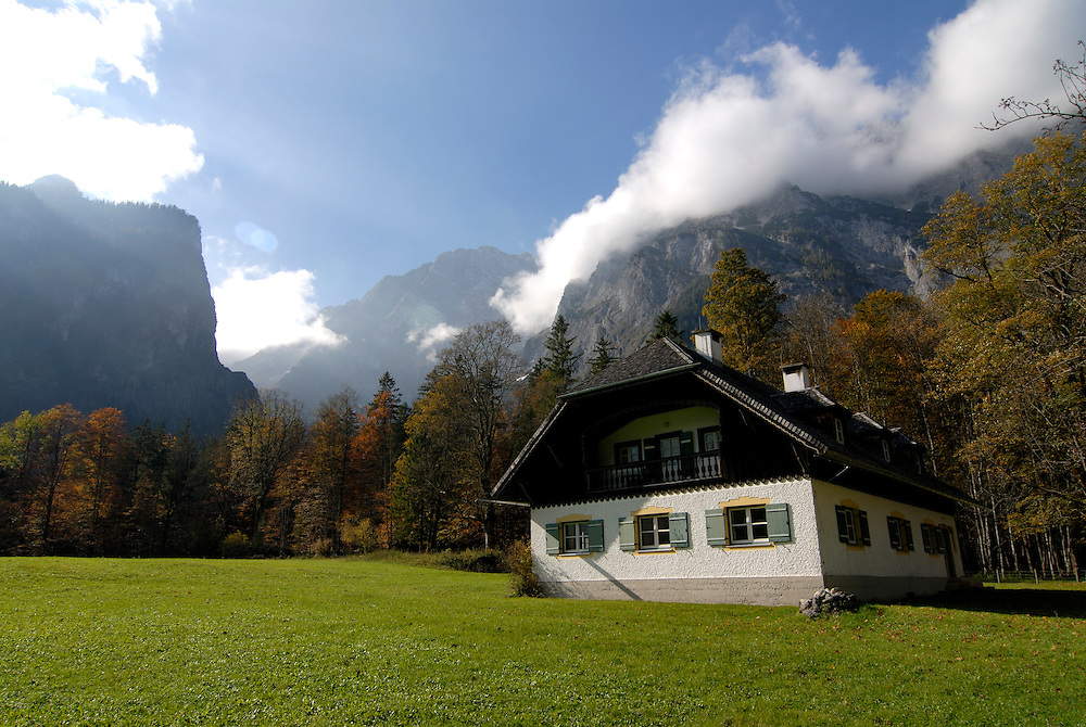 A farmhouse in the background the Watzman, Berchtesgadener land National park, Bavaria, Germany