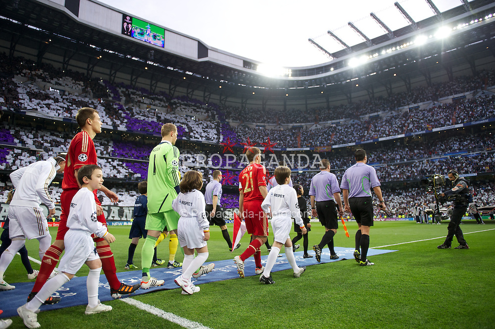 MADRID, SPAIN - Wednesday, April 25, 2012: FC Bayern Munchen's captain Philipp Lahm leads his side out to face Real Madrid during the UEFA Champions League Semi-Final 2nd Leg match at the Estadio Santiago Bernabeu. (Pic by David Rawcliffe/Propaganda)