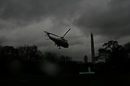 Marine One takes off from the South Lawn of the White House on a dark and stormy day.  Photo by Dennis Brack