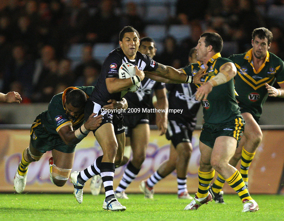 Benji Marshall of New Zealand is tackled by Paul Gallen and Petero Civoniceva of Australia. Australia v New Zealand, Four Nations, Rugby League, The Stoop, Twickenham, 24/10/2009 © Matthew Impey/Wiredphotos. co. uk. tel: 07789 130 347 email: matt@wiredphotos. co. uk