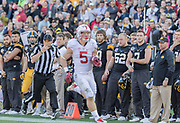 PASADENA, CA - JANUARY 1:  Members of the Iowa Hawkeyes football team watch Christian McCaffrey #5 of the Stanford Cardinal running with the ball during the 102nd Rose Bowl game between Stanford and Iowa played on January 1, 2016 at the Rose Bowl stadium in Pasadena, California.  (Photo by David Madison/Getty Images) *** Local Caption *** Christian McCaffrey
