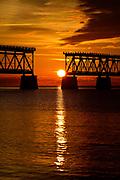 Sun setting between the pilings of the old Bahia Honda railway bridge in the Florida Keys