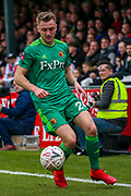 Watford defender Ben Wilmot (24) on the ball during the The FA Cup 3rd round match between Woking and Watford at the Kingfield Stadium, Woking, United Kingdom on 6 January 2019.
