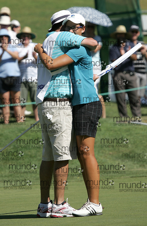 (Canberra, Australia---30 January 2011) Ashley Ona (Amateur) of Queensland, Australia hugs her cady after winning the ActewAgl Royal Canberra Ladies golf tournament as part of the 2011 Australian Ladies Pro Golf Tour./ 2011 Copyright Sean Burges. For Australian editorial sales, contact seanburges@yahoo.com.