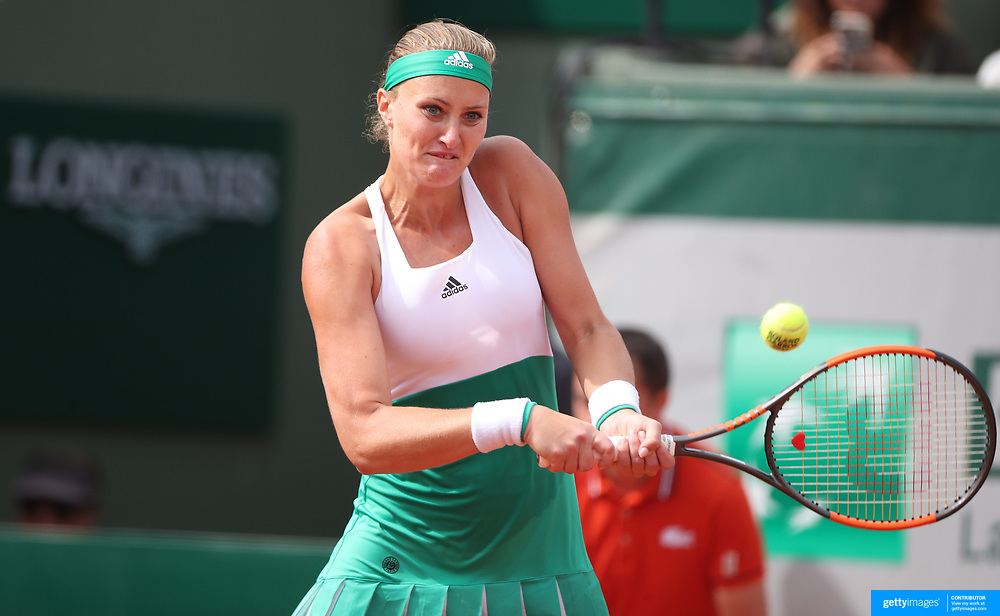 2017 French Open Tennis Tournament - Day Eight.  Kristina Mladenovic of France in action against Garbine Muguruza of Spain in the Women's Singles round four match in front of a full house on Suzanne-Lenglen Court at the 2017 French Open Tennis Tournament at Roland Garros on June 4th, 2017 in Paris, France.  (Photo by Tim Clayton/Corbis via Getty Images)