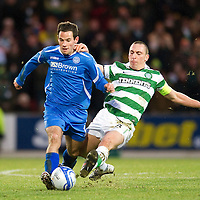 St Johnstone v Celtic...18.12.11   SPL <br /> Kevin Moon tackled by Scott Brown<br /> Picture by Graeme Hart.<br /> Copyright Perthshire Picture Agency<br /> Tel: 01738 623350  Mobile: 07990 594431