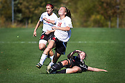 Grinnell Forward Julia Sauerhaft '15 is brought down by a Lake Forest midfielder during the Pioneers' 5-1 victory at home on October 8th.