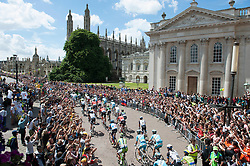 Image ©Licensed to i-Images Picture Agency. 07/07/2014. Cambridge, United Kingdom. Tour de France Stage 3 Cambridge. Riders pass Cambridge City Centre. Picture by Terry Harris / i-Images