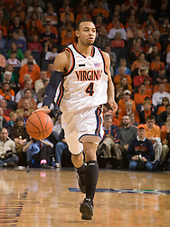 Virginia guard Calvin Baker (4) dribbles up court against Maryland.  The Virginia Cavaliers defeated the Maryland Terrapins 91-76 at the University of Virginia's John Paul Jones Arena  in Charlottesville, VA on March 9, 2008.