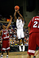 25 November 2005: Freshman forward for Monmouth University, Whitney Coleman (5) takes a shot over USC junior guard, Tre Kelley (1) in the 56-62 loss to South Carolina at the Great Alaska Shootout in Anchorage, Alaska