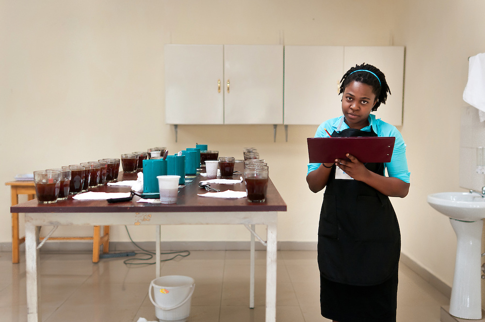 Liana Ishinwe, 25, has been cupping coffee in Rwanda for three years.  She scores coffee for Rwanda's Cup of Excellence Pre-Trials. Kayonza, Rwanda.