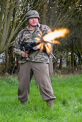 Re-encator portraying a German panzer grenadier test fires fires a 'section' 5 MG42 machinegun from the hip during the Pickering Wartime weekend on the Pickering Showground<br />