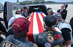 April 4, 2017 - Tampa, Florida, U.S. - The flag draped casket containing the remains of Mark Dennis is loaded into a hearse by members of the Patriot Guard Tuesday, at Tampa International Airport. The remains returned to Tampa Bay eight months after the military concluded for the fourth time that they belonged to Dennis. The first time was in July, 1966, just days after Dennis, a Navy Hospital Corpsman 3rd Class, was in a helicopter shot down in Vietnam, making him the first casualty of the war from his small town south of Dayton, Ohio. (Credit Image: © Chris Urso/Tampa Bay Times via ZUMA Wire)