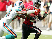 MIAMI - NOVEMBER 6:  Running back Warrick Dunn #28 of the Atlanta Falcons gets tackled close to the goal line by safety Travares Tillman #26 of the Miami Dolphins on a running play that set up a Falcons touchdown in the game on November 6, 2005 at Dolphins Stadium in Miami, Florida. The Falcons defeated the Dolphins 17-10. ©Paul Anthony Spinelli *** Local Caption *** Warrick Dunn;Travares Tillman