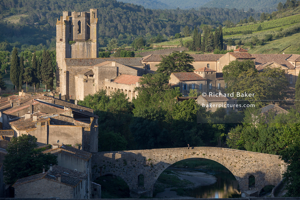 Aerial landscape overlooking the pretty French medieval walled village of Lagrasse and the tower of the Abbey of Sante-Marie D'Orbieu, on 23rd May, 2017, in Lagrasse, Languedoc-Rousillon, south of France. Lagrasse is listed as one of France's most beautiful villages and lies on the famous Route 20 wine route in the Basses-Corbieres region dating to the 13th century.