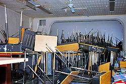 School books, tables and chairs are pilled up inside the former Germantown Settlement Charter school Creative & Performing Arts Center. (Bas Slabbers/for NewsWorks)