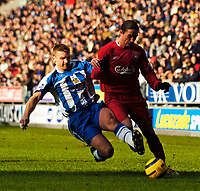 Photo: Jed Wee.<br />Wigan Athletic v Liverpool. The Barclays Premiership. 11/02/2006.<br />Liverpool's Harry Kewell (R) is tackled by Wigan's Gary Teale.