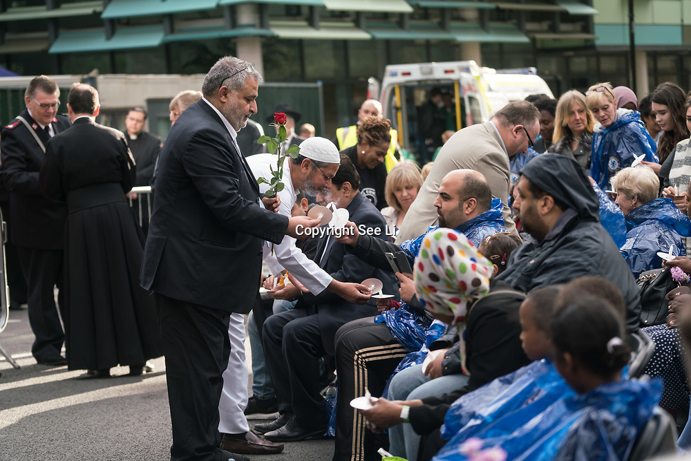 London, England, UK. 27th July 2017. Religious leaders and hundreds of people attend a memorial for Grenfell Tower victims at St Clements Church.