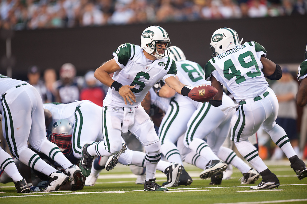 EAST RUTHERFORD, NJ - SEPTEMBER 19: Mark Sanchez #6 of the New York Jets hands off the ball against the New England Patriots during the game on September 20, 2010 at the New Meadowlands Stadium in East Rutherford, New Jersey.The Jets defeated the Patriots 28 to 14. Mark Sanchez(Photo by Rob Tringali)