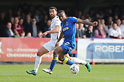 AFC Wimbledon striker Dominic Poleon (10) and Northampton Town defender Lewin Nyatanga (22) during the EFL Sky Bet League 1 match between AFC Wimbledon and Northampton Town at the Cherry Red Records Stadium, Kingston, England on 11 March 2017. Photo by Stuart Butcher.