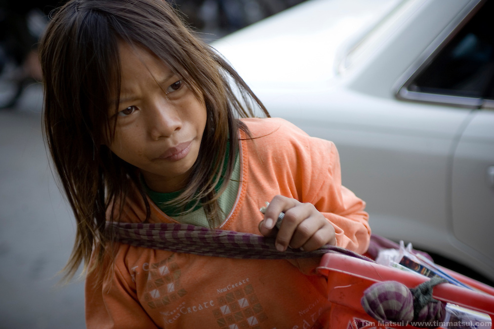 Nat, a young book seller in downtown Phnom Penh, Cambodia. Initially Nat said she would sell books in order to go to school. Later she disclosed her parents collect the money and that she doesn't go to school, nor does she have an interest. In Cambodia public education is not free.