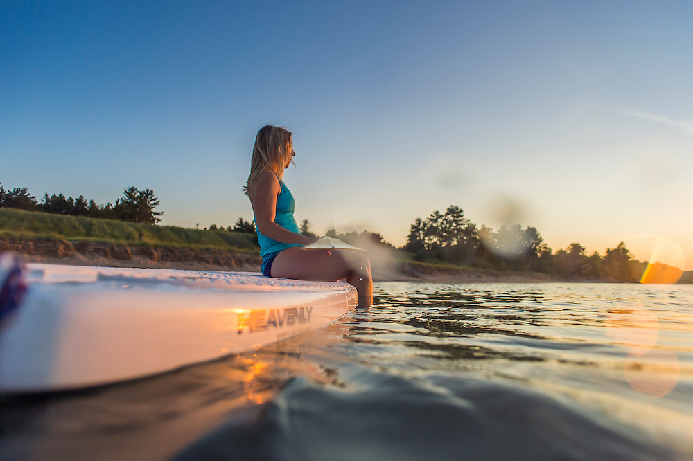 SUP stand up paddling on Lake Superior near Marquette, Michigan.