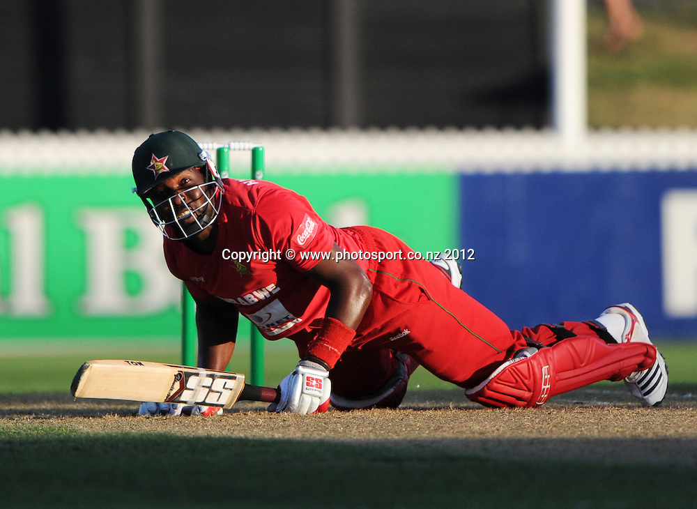Hamilton Masakadza falls down during the 2nd Twenty20 InternationaI cricket match between New Zealand and Zimbabwe at Seddon Park in Hamilton, New Zealand on Tuesday 14 February 2012. Photo: Andrew Cornaga/Photosport.co.nz