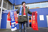 a seller of scarf's outside Loftus Road Stadium before k/o. Barclays Premier league match, Queens Park Rangers v Manchester Utd at Loftus Road in London on Saturday 17th Jan 2015. pic by John Patrick Fletcher, Andrew Orchard sports photography.