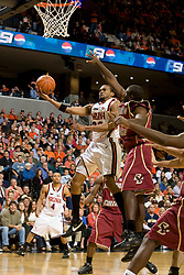 Virginia forward Adrian Joseph (30) beats Boston College guard Biko Paris (5) to the basket.  The Virginia Cavaliers men's basketball team defeated the Boston College Golden Eagles 84-66 at the John Paul Jones Arena in Charlottesville, VA on January 19, 2008.