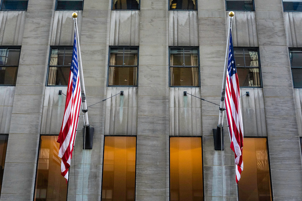 United States Flags adorn the outter walls of the buildings in Manhattan, New York.