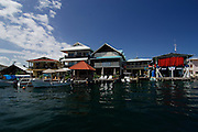Motor boats moored at docks of sea side hotels. Colon Island, Bocas del Toro, Panama, Caribbean, Central America.