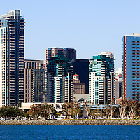 High resolution photo of San Diego California skyline close-up with downtown city buildings along the San Diego Bay waterfront in Southern California.