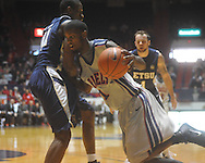 "Ole Miss forward Terrance Henry (1) dribbles against East Tennessee State's Isiah Brown (41) at the C.M. ""Tad"" Smith Coliseum in Oxford, Miss. on Saturday, December 18, 2010. Ole Miss won 71-50."